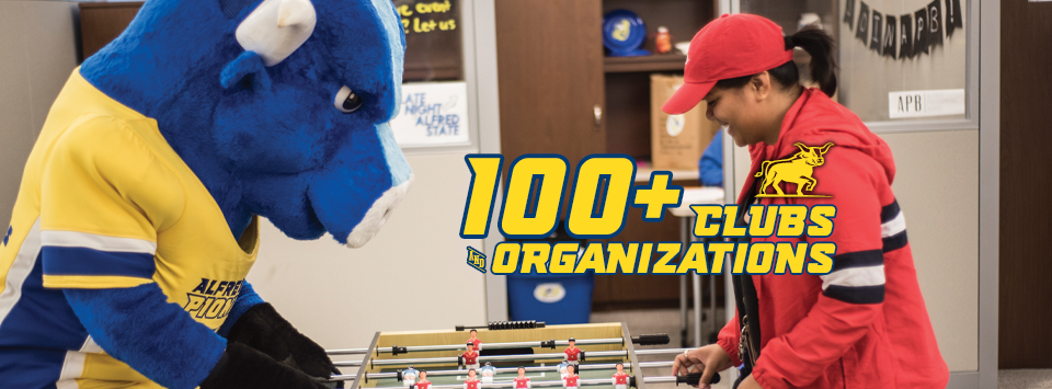 100+ Clubs and Organizations. Image of Big Blue (mascot) playing foosball with a student in a red hoodie and hat.