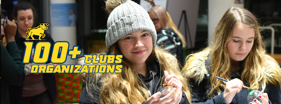 100+ Clubs and Organizations. Image of students wearing winter hats and jackets, painting ornaments.