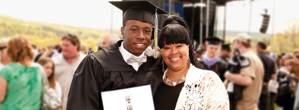 mother with son in his commencement cap holding his diploma