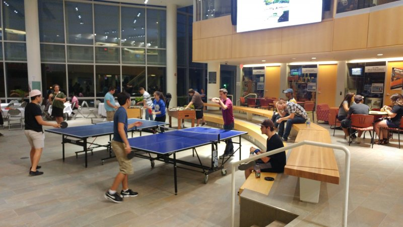 students playing ping pong in the Student Leadership Center
