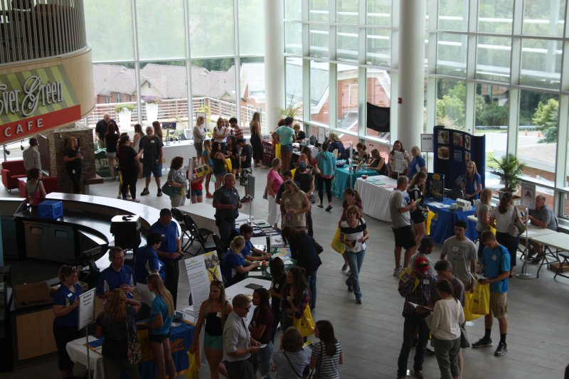students visiting tables in the Student Leadership Center on campus