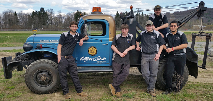 Alfred State students along with the 1953 Dodge Power Wagon they will use to compete in this year's Great Race