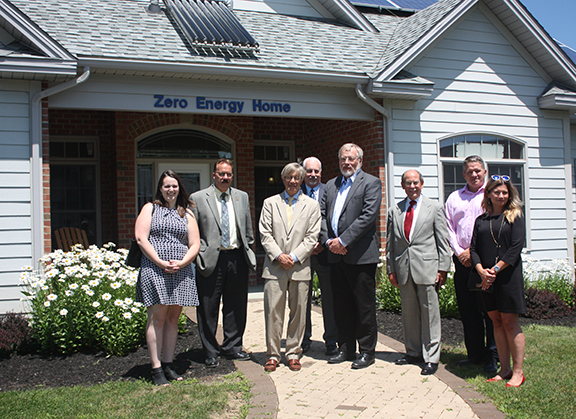 ARC representatives standing in front of the Zero Energy Home