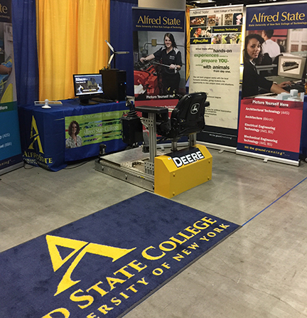 A heavy equipment simulator was one of the highlights of Alfred State College's recruiting booth at the 91st annual National FFA Convention and Expo in Indianapolis, IN.