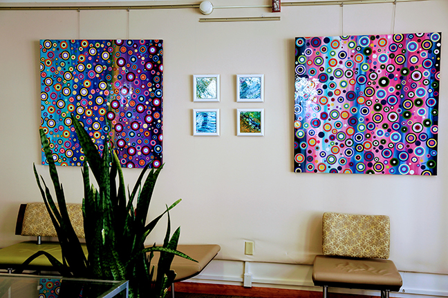 paintings hanging on the wall by Ithaca artist Ivy Stevens-Gupta