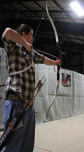 Ethan Frederick takes aim with his bow
