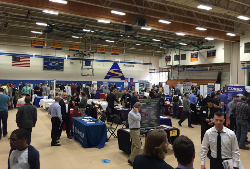 students and employers and tables set up in the gymnasium