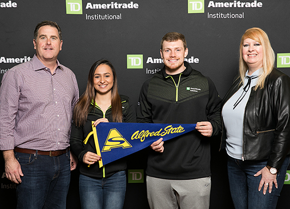 Pictured at TD Ameritrade's 2018 National LINC Conference in Orlando, FL, from left to right, are Tom Nally, president, TD Ameritrade Institutional; Alfred State financial planning majors Madison Webster and Adam Wilkins; and Kate Healy, managing director, Generation Next, TD Ameritrade Institutional.