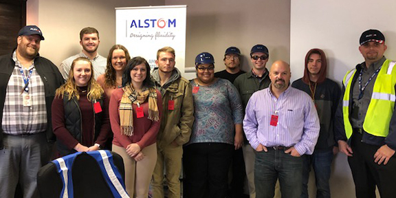 group of students at the Alstom facility