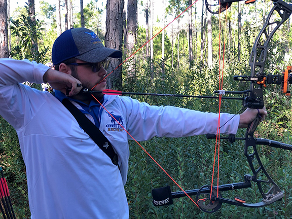 Team member Jacob Houseknecht, culinary arts, Candor, draws his bow during the USA Archery Collegiate 3-D National Championships in Foley, AL.