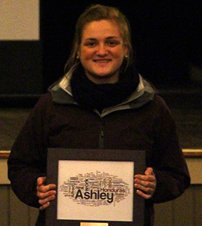 Ashley Ebel, a business administration major from Freeville, proudly displays her Alfred State College Student Spirit of Service Award.