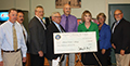 check presentation after Catharine Young's announcement on Sept. 17