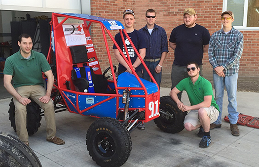 Baja team with vehicle