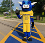 mascot in crosswalk