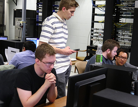 male students in a computer lab