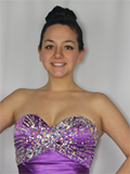 Erin Crotty modeling a purple prom dress