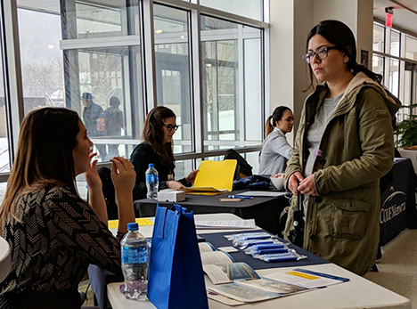 student speaking with an employer at career fair