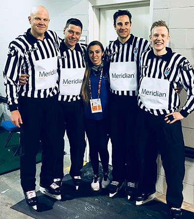 Cassidy, center, with some of the officials