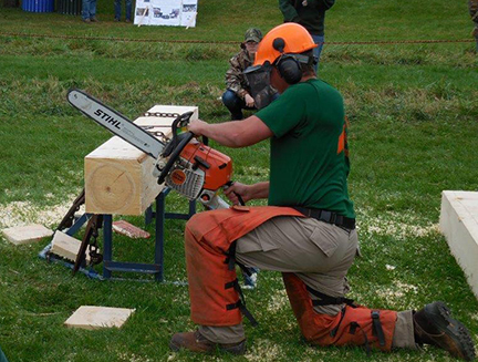 Pioneer Woodsmen's Club member Gavin Maloney, a masonry major from Rome, NY, takes part in the chainsaw event