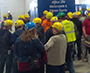 several students wearing yellow hard hats