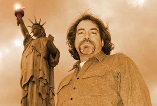 Dennis Heaphy with Statue of Liberty behind him
