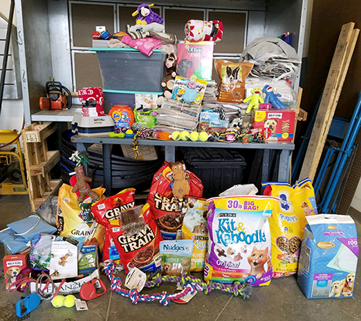 items collected for local animal shelters during a recent food and supply drive; dog food, chew toys, etc.