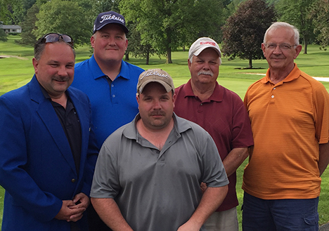 winners of the Alfred State Inaugural Golf Tournament, along with Charles Wiser, who donated the blue jacket that was given to the captain of the team. In the front row is Alfred State University Police Campus Public Safety Officer Craig Heller. In the back row, from left to right, are Alfred State University Police Lt. Matt Heller, Jeff Wilcox, Walt Heller, and Wiser.