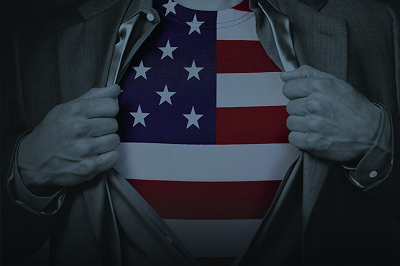 man holding suit coat open at chest with American flag showing thru