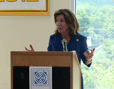 Lt. Gov. Kathy Hochul in front of a podium