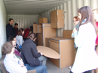 students inside a container they utilized for a recent housing-design project