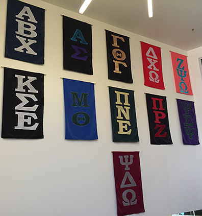 Banners of Greek letters hanging in SLC