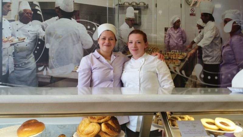 two female students in a bakery