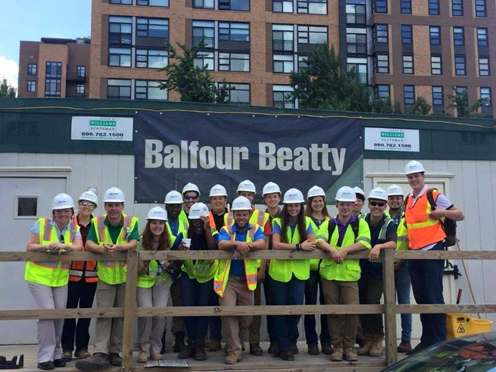 Alfred State Intern at Balfour Beatty, many people standing outside wearing hard helmets and yellow safety vests
