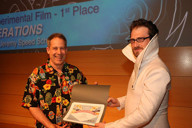 Jeremy Speed Schwartz, right, receives his award for first place from Animator Robert Lyons