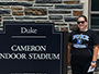 sport management major Kiana Sleight next to Duke stadium sign