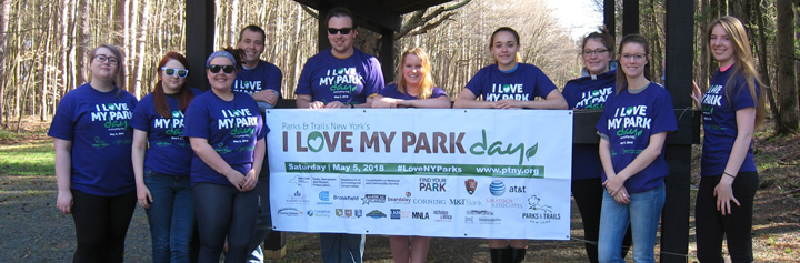 students holding a sign that says I love my park day