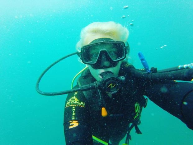female under water wearing scuba gear