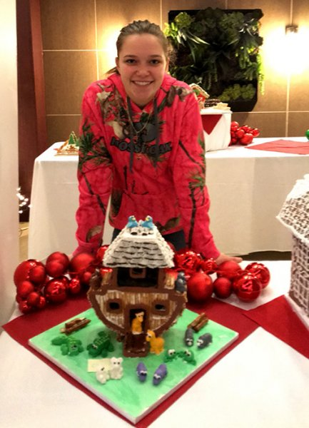 Makayla Reiss with her Noah's Arc-themed gingerbread house