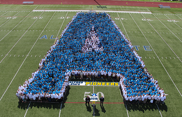 Students, faculty, and staff create a human Alfred State College logo