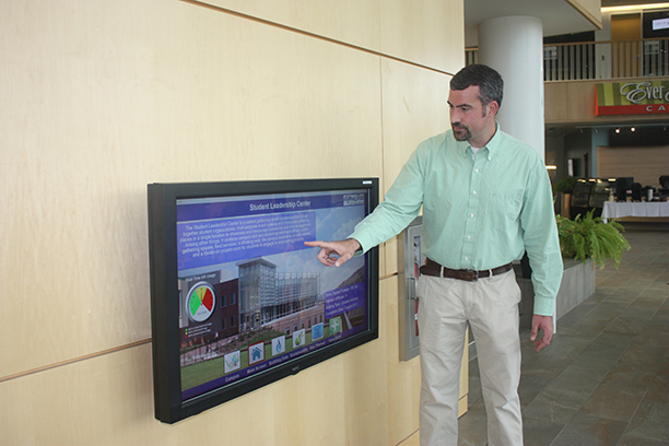 Mike Smith, manager in Technology Services, observes readings from the energy efficiency monitor