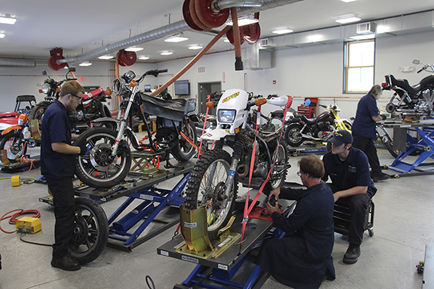 students working on motorcycles in the lab