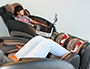 Two students relaxing in massage chairs