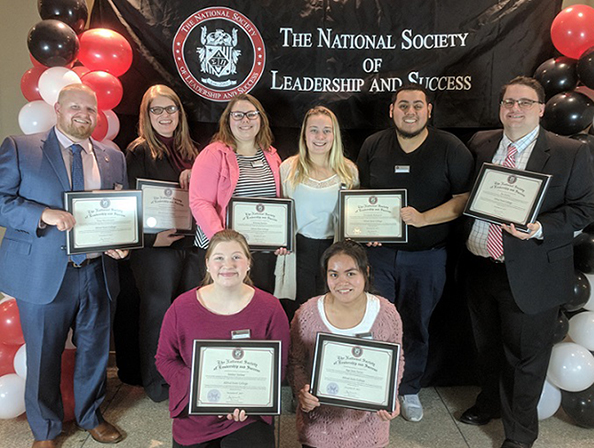 new members of Alfred State's chapter of the National Society of Leadership and Success holding their certificates