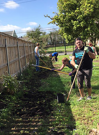 Alfred State volunteers work on creating a wetland exhibit area on a recent civic engagement project trip to New Orleans.