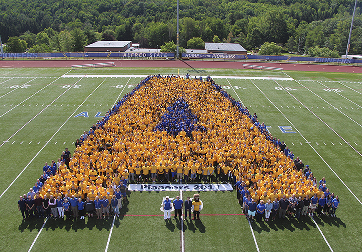 Students, faculty, and staff create a human Alfred State logo