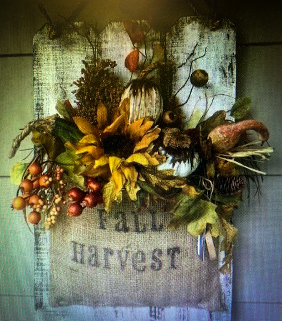 wood craft of a harvest bag and flowers