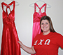 Olivia Ciesla with 2 red prom dresses