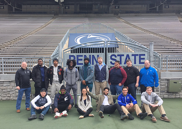 several students at Penn State's Beaver Stadium