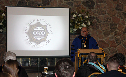 Alfred State President Dr. Skip Sullivan speaks during a Phi Kappa Phi honor society induction ceremony
