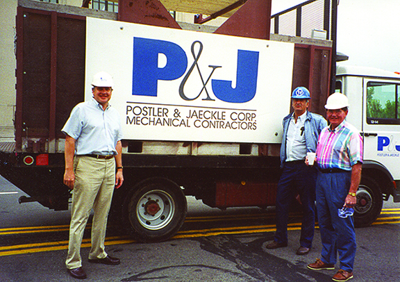men standing in front of a truck